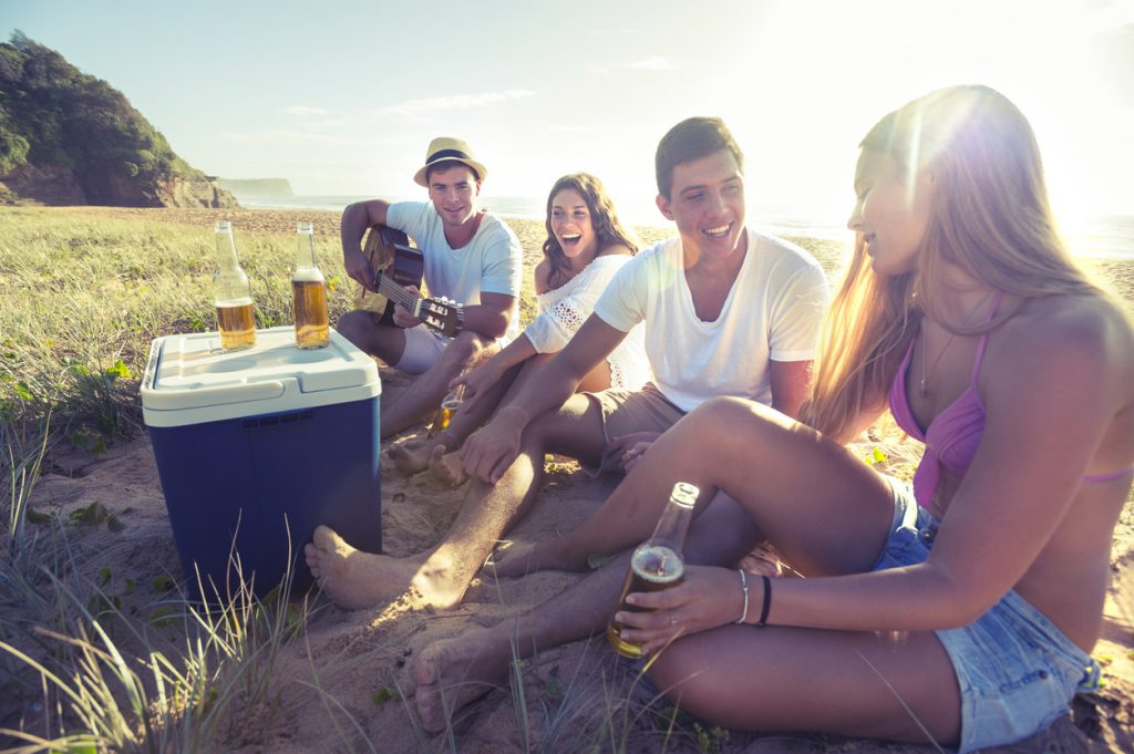most important things to keep in your RV - friends drinking beer from cooler