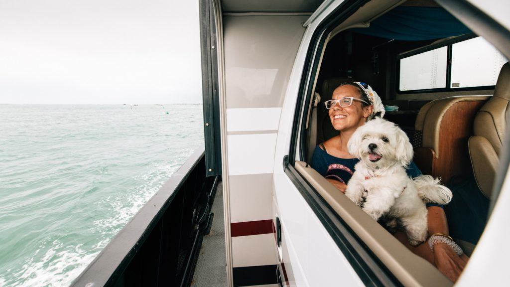 RV with dogs Family on RV Road Trip during summer vacation. Crossing on free ferry ride service to Outer Banks in North Carolina.