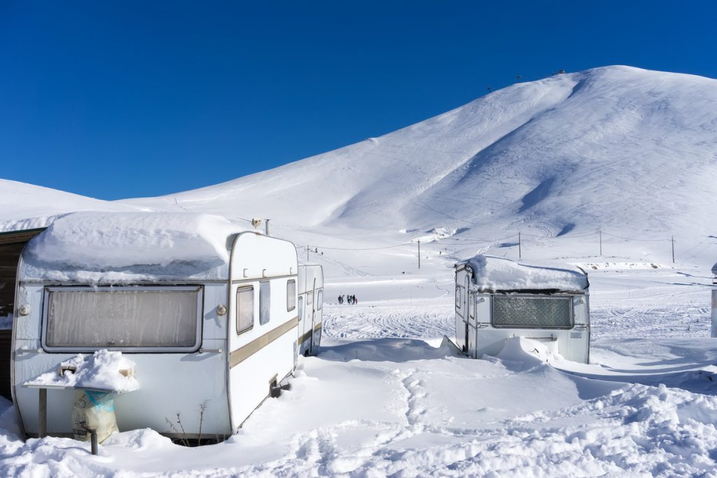 RVs covert in snow at Falakro, in Greece.