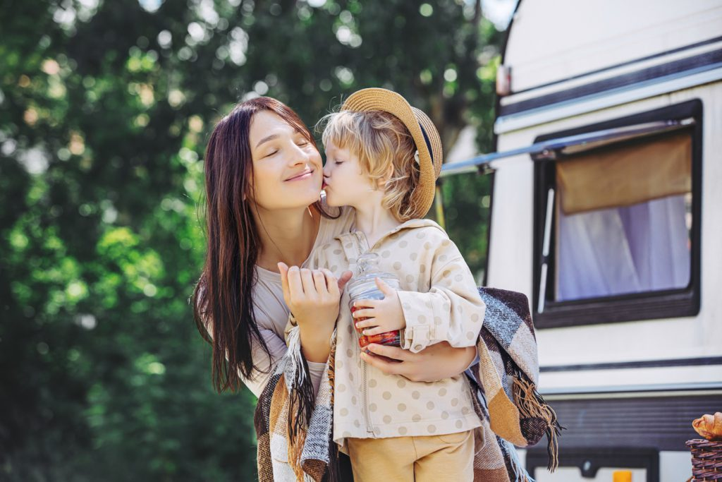 RVing with a baby - Family mother and daughter in nature relax traveling in a trailer, a motor home